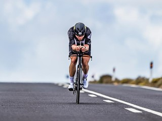 Triathlete cycling on asphalt road during IRONMAN Lanzarote 2019