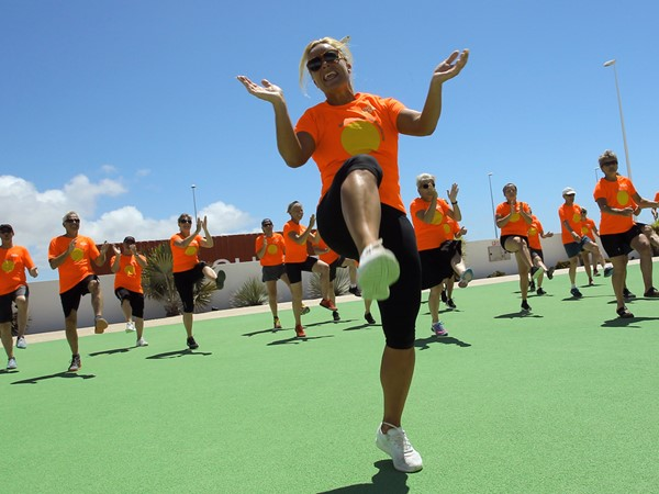 Group of people taking part of a Swingtime Ballroom Fitness class at the Volcano