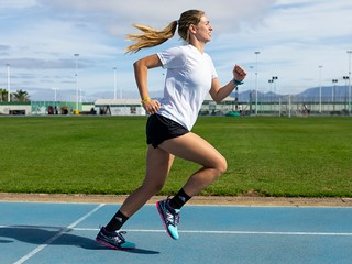 Young woman training in the athletic track