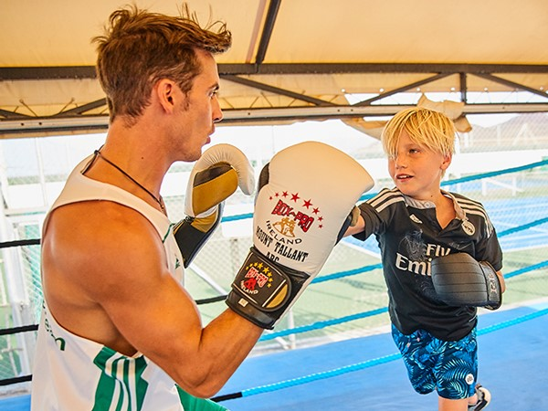 Kid enjoying boxing training with Green Teamer