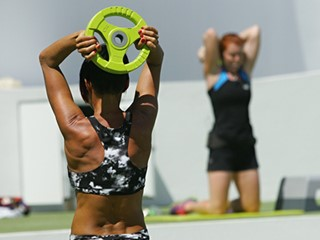 Woman lighting weights during body toning class