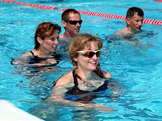 two women and two men doing aqua jogging class