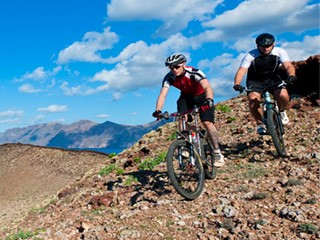two mountain bikers downhilling the volcanos