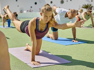group of people activing their energy with dynamic yoga class at club la santa